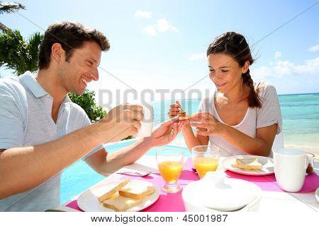 Couple enjoying breakfast in resort