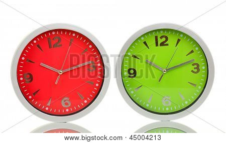 Round office clocks isolated on white