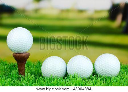 Golf balls on grass outdoor close up