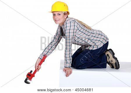 Woman laborer with vernier caliper