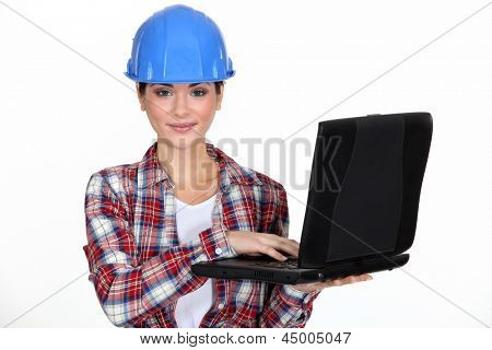 young craftswoman with laptop