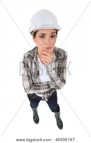 A worried tradeswoman