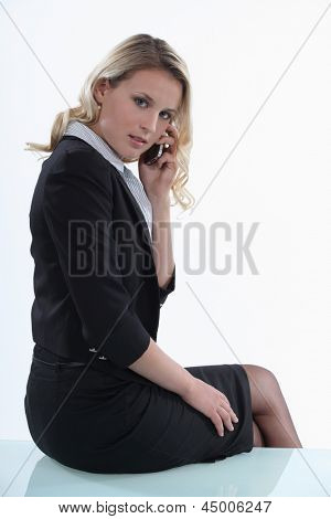Woman sitting on the table with mobile