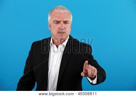 Stern businessman pointing