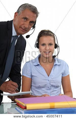 young female receptionist and mature male counterpart