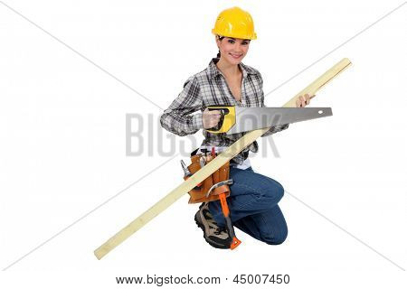 A female carpenter with a handsaw.