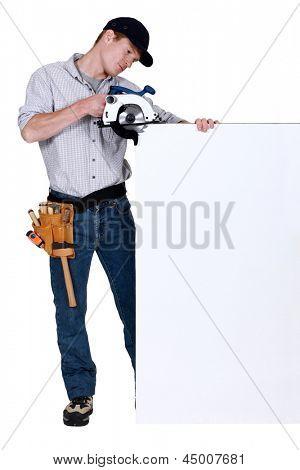 Tradesman using a circular saw