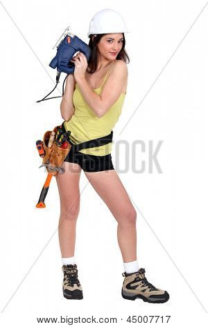 Sexy woman with chainsaw