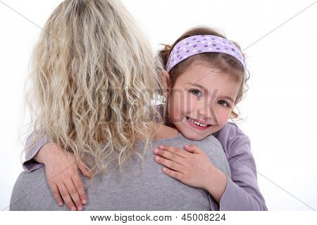 Young girl hugging her mother