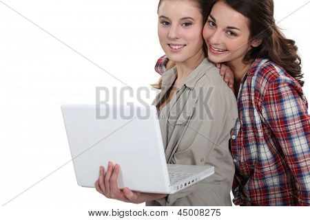 Students working together with laptop
