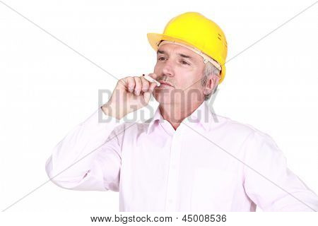 A male architect smoking.