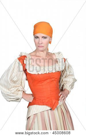 Woman in pantomine outfit, frowning with her hands on her hips