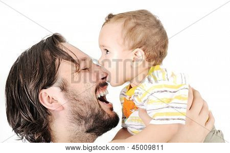 Happy young man holding a smiling 1-2 years old baby