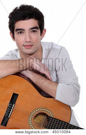 A man with a guitar.