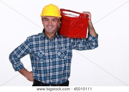 Man with a toolbox on his shoulder