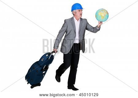 construction businessman holding a globe and a suitcase