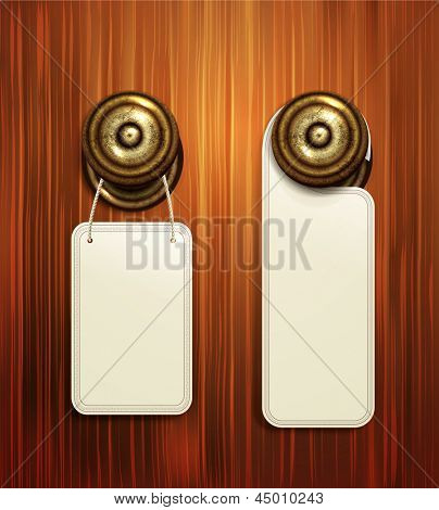 hotel handles with hanging signs on the wooden background