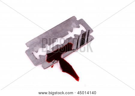 razor with drop of blood on white background