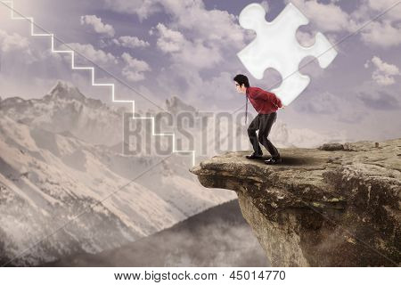 Businessman Walk Up With Puzzle On Mountain