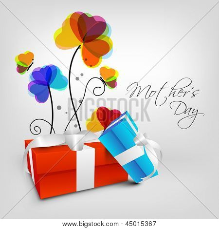 Happy Mothers Day background with flowers and gift boxes on grey background.