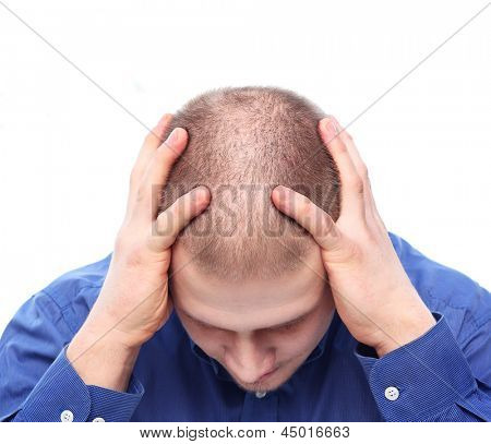 Young man with rare hair depressed.