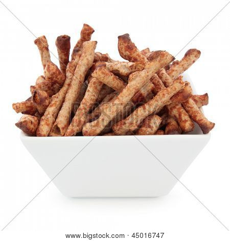Twiglet savoury beef snacks in a porcelain square dish over white background.