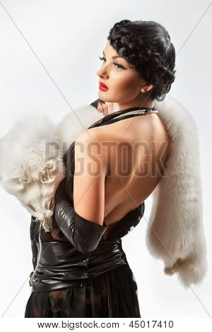 Retro portrait of sexy caucasian young woman model with with white fox fur collar