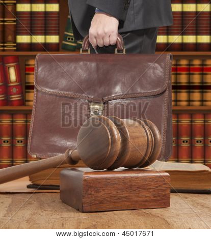 Lawyer with a brown briefcase in the courtroom
