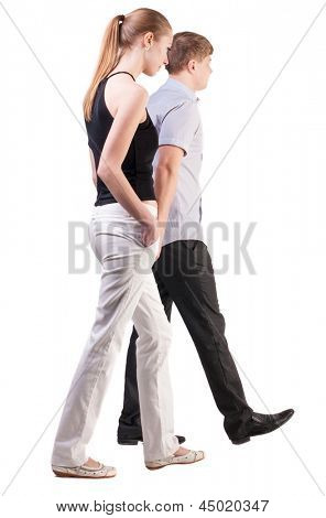 Back view of walking  young couple (man and woman).  Rear view people collection.  backside view of person.  Isolated over white background. a pair of office workers are sad about his business