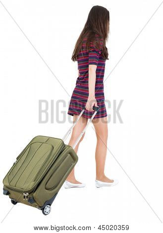 back view walking woman with green suitcase. beautiful brunette girl in motion.  backside view person. Rear view people collection. Isolated over white background. Woman office worker rolls brown bag