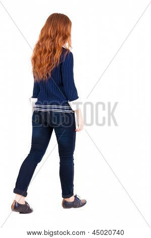 back view of walking  woman . beautiful redhead girl in motion.  backside view of person.  Rear view people collection. Isolated over white background. red-haired girl in office clothes goes ahead