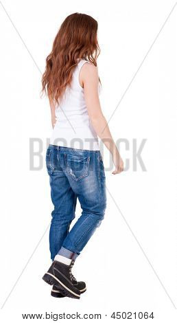 back view of walking  woman . beautiful redhead girl in motion.  backside view of person.  Rear view people collection. Isolated over white background. Teenager girl with long curly red hair goes away