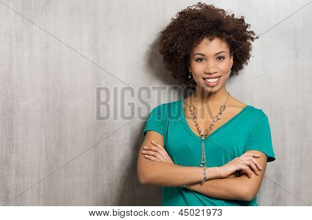 Confident Young Woman With Arms Crossed