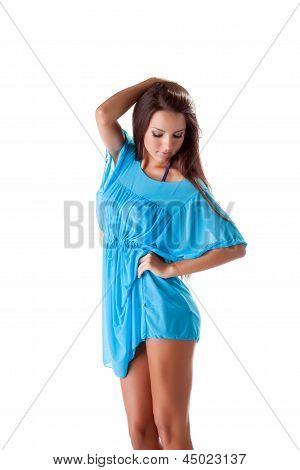 Portrait of pretty girl posing in blue nightdress