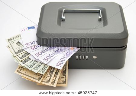 Closed Cashbox With Money On White