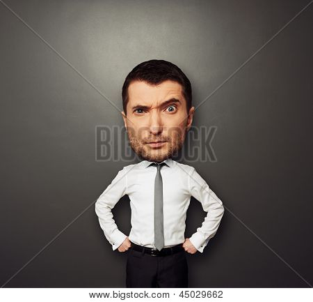 funny picture of businessman with big head over dark background