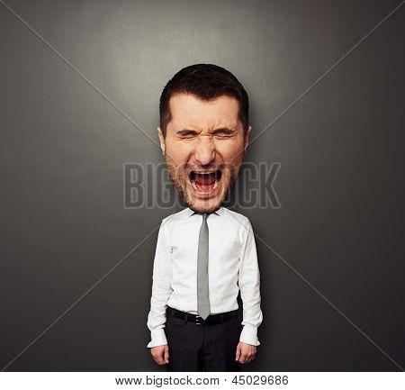 photo of bighead screaming man over dark background