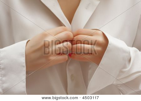 Young Girl Unbuttoning Shirt