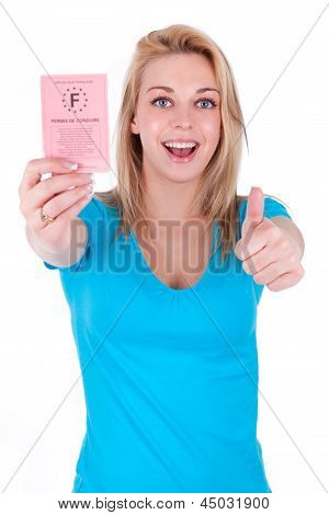 Happy Caucasian Teenage Girl Showing Her Driving License And Making Thumbs Up - Caucasian People