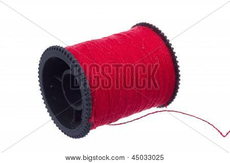Red Thread On Black Plastic Spool
