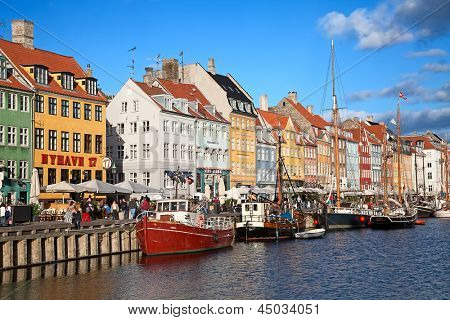 COPENHAGEN, DENMARK - AUGUST 25: unidentified people enjoying sunny weather on the Nyhavn promenade on August 25, 2010 in Copenhagen, Denmark. Nyhavn is one of the most famous landmark of Copenhagen.