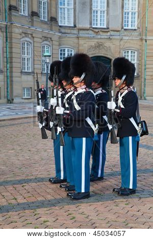 COPENHAGEN, DENMARK - AUGUST 25: unidentified soldiers of the Royal Guard in Amalienborg Castle by changing the guards on August 25, 2010 in Copenhagen, Denmark