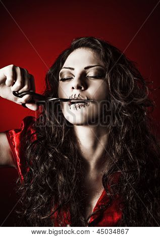 Horror Shot: Strange Girl With Mouth Sewn Shut Cutting The Thread