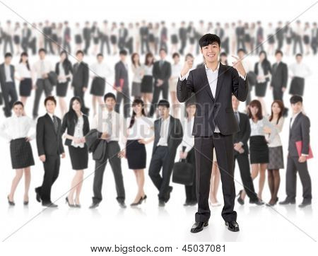 Young cheerful businessman of Asian point at himself and stand in front of huge group business people on white background. Concept of cheerful, confident, successful and volunteer idea.
