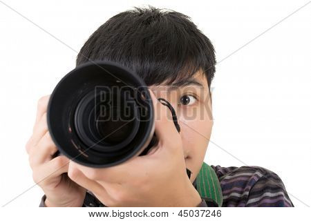 Young amateur photographer of Asian hold a camera, closeup portrait on white background.