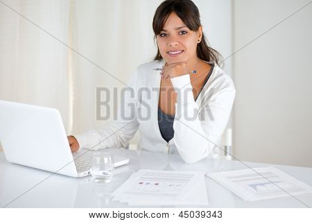 Working Young Woman Looking At You At Office