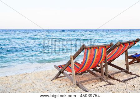 Colorful Beach Chairs On The Beach