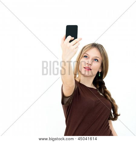 beautiful woman looking at a smart phone and taking photo on white background