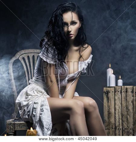 Sad Woman With Candles