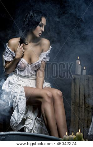 Sad Woman With Candles And Bath